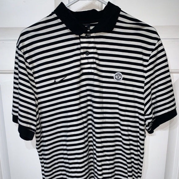 2d509863 Men's White Black Nike Manchester United MUFC Polo.  M_5bea56a3e944ba349e7bf826. Other Shirts you may like. Nike Golf Striped  Polo, XL, Standard fit